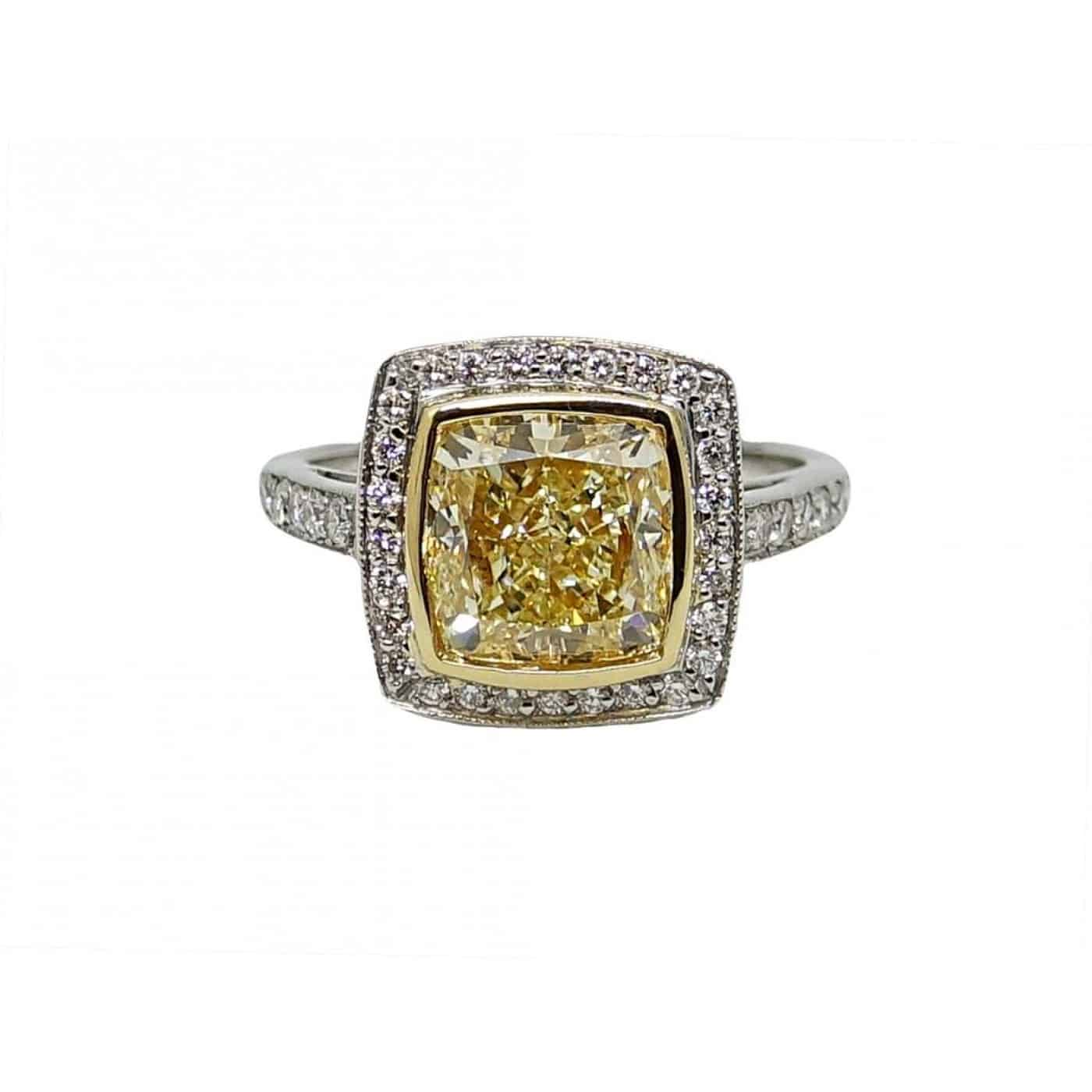 Gold and Platinum Engagement Ring with Light Yellow Radiant Cut Diamond